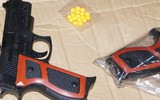 Dùng súng giả để cướp tài sản của hàng