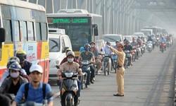 Không vội vàng thí điểm hạn chế xe máy ở đường Lê Văn Lương hoặc Nguyễn Trãi